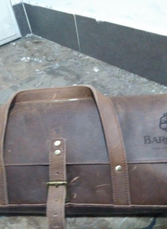 Grabación de maleta de piel personalizada para Barceló completa con maquina laser